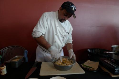 Don Ho's Robert Denis mixing his rice.